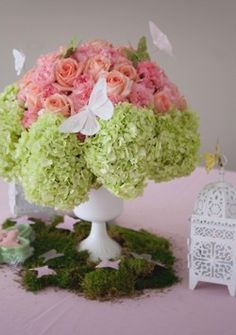 Pretty centerpiece! I love the use of butterflies and soft pastels.