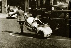 "This very small car may qualify better, to some minds, as a scooter with a body, or perhaps as a deficient power mower. You steer it with a handlebar and you start it by pulling a cord. ""It roars into life with a pull of a cord,"" is the way our London informant puts it—and from now on we greet anything he tells us with hurt distrust. It's called the Brutsch Mopetta, it has three wheels, costs 560 dollars and has a top speed of 21 mph. Its obvious role is in home-to-station and city driving."
