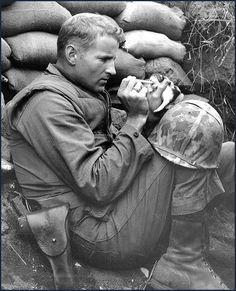 Feeding a kitty somewhere in Korea, 1950-53.