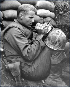 Feeding a kitty somewhere in Korea, 1950-53.