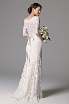 lace wedding dress with sheer back and column of button @myweddingdotcom