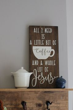 All I need is a little bit of coffee and a whole lot of Jesus sign details: ITEM OVERVIEW:  Sign is (approx.) 7.25x16. Comes with a hanger on the back Dark wood station with a creamy white lettering. sealed with one coat of matte finishing spray or wax paste. The only item for sale is the sign itself, all others are considered props and will not be sent with your sign.  This sign is able to have mug hooks (not pictured) added, message me for prices. Please note, it wil...