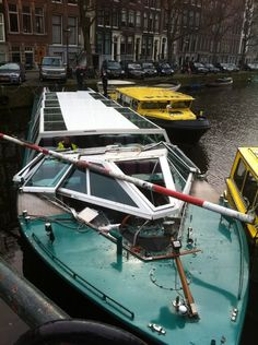 There was no way a tourist canal boat was ever going to get under the bridge - what were they thinking?