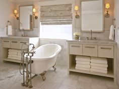 His-and-Hers Intimacy  Sometimes luxury simply means a sense of intimacy in a room. By placing this footed bath right in the middle of the his-and-hers vanities, we know this certainly isn't the guest bath. It's a romantic little reminder this space has been customized for the couple who owns it.