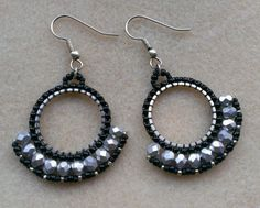 Silver and black fan, dangle earrings. Beaded. Handmade. Made in Denmark. Etsy listing at https://www.etsy.com/dk-en/listing/214810518/fan-dangle-earring-in-black-and-silver