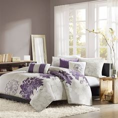 Lola is the perfect solution to an updated, modern print look. This duvet cover collection features an overscaled floral print design printed on 100% cotton fabric for a super soft hand feel. The reverse of the cover is a soft grey color that coordinates with the grey, white and purple from the face of the duvet. The decorative pillows feature embroidery and piecing details.