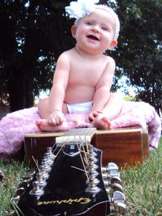 Outdoor baby photography (My 8 month old Lakota on her daddy's guitar)