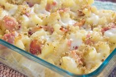 Recipe including course(s): Entrée; and ingredients: bacon, basil leaves, black pepper, blue cheese, bread, elbow macaroni, extra-sharp cheddar cheese, flour, gruyere cheese, kosher salt, milk, nutmeg, unsalted butter, vegetable oil