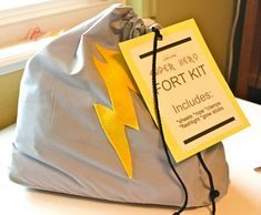 Fort Kit includes sheets, rope, clamps, flashlight and glow sticks. Such a great idea!