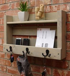 For over the hall table--put my own spin on this--2 shelves with a small ip for glasses, hooks on the from for keys