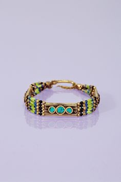 """Moon Shield Bracelet  Vintage-inspired bracelet featuring turquoise-inset brass spacers and multicolor glass beaded detailing. Hook closure with logo charm. Looks amazing paired with a maxi dress and strappy platforms! By Vanessa Mooney.  *Approx. 2"""" width  *0.35"""" height  *Made in USA"""