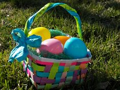 Hi!  This is a simple, easy way to make fabulous paper Easter baskets:)  They are really easy to weave and are made out of colored paper that I have gotten from handouts, flyers, reminders, etc, so they are super cheap (free, in fact;)  Let's get started.