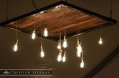Handmade hanging edison bulb chandelier   Photo credit Creation Studios in Memphis Tn
