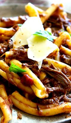 Braised Beef Ragu Recipe ~ it's super easy—quarter the meat, braise it, saute your seasonings, then into the oven it goes
