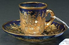 820: A GOOD MOSER SILVERED AND GILT DEMITASSE CUP AND