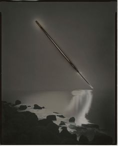 Photographer Chris McCaw uses the power of the sun to burn markings into his photographs, destroying small areas to appear like the sun itself. McCaw stumbled upon the technique for his series Sunburnafter forgetting to close the shutter during an all night exposure. The light of the morning sun de