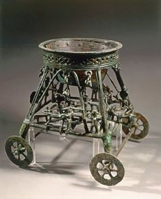 Small four-wheeled bronze chariot with human figures, from Bisenzio (Tuscany region, Italy)