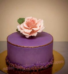 Single tier purple cake with edible rose