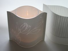 Light the candle and enjoy the dance of light on the paper. Lantern, 20 cm height. www.paperivalo.fi