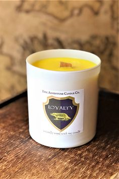 "We've been quiet because we've been so busy! We have a huge announcement coming soon, so ""stay tuned""! But now, we're excited to share the latest addition to our Wizardly Line: House Candles! Soy Candles, Candle Jars, House Candles, Harry Potter Candles, Geek Gifts, Stay Tuned, Hogwarts, Announcement, Wicked"