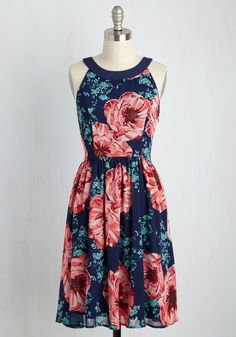 For an in-house dance party or outdoor adventure with your sweetie, this navy dress is the ideal ensemble! From its rounded collar to its lush print of warm-hued blooms, this tie-back frock provides endless possibilities for fun romance. #ad