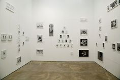 """""""Assembly Instructions (Tangential Logic)"""", 2008 by Alexandre Singh. Framed Xerox collages and pencil wall drawing."""