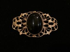A personal favorite from my Etsy shop https://www.etsy.com/listing/260444490/vintage-black-oval-stone-gold-brooch