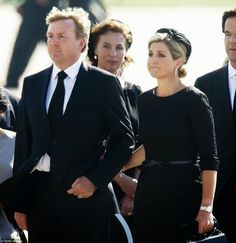 23 JULY 2014 King Willem-Alexander of the Netherlands stands with Queen Maxima of the Netherlands as victims of MH17 arrived in The Netherlands.