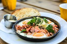 House smoked trout baked eggs with creme fraiche, herbs and toast