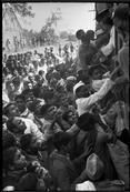 India.  Delhi. 1948. The train carrying Gandhi's ashes to the river Ganges, where they were to be scattered. Crowds lined the railway tracks to see and touch Gandhi's ashes, and pay a last tribute to their leader // Henri Cartier Bresson