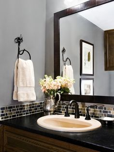 Small band of glass tile is a pretty AND cost-effective backsplash for a bathroom by sam.maynard.7543
