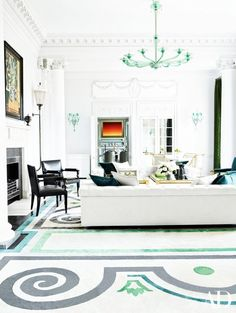 Elegant living room with a 1932 Picasso above the living room mantel and a sea foam green chandelier