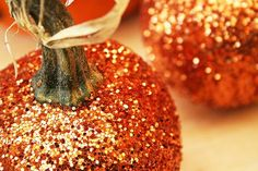 Add glitter to pumpkins for a sparkly, festive look. Dishfunctional Designs: Decorating With Unusual & Unique Pumpkins for Autumn and Halloween Plastic Pumpkins, Glitter Pumpkins, Halloween Pumpkins, Halloween Decorations, Halloween Ideas, Glitter Decorations, Mini Pumpkins, Thanksgiving Decorations, Diy Pumpkin