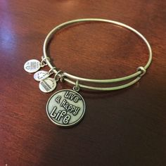 "Alex and Ani ""Live a Happy Life"" bracelet Adorable Alex and Ani bracelet give to me for my birthday! Dangling bracelets aren't my thing so I never wore it! Alex & Ani Jewelry Bracelets"