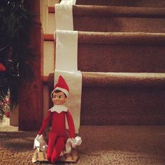 """Our Elf rolled TP down the stairs and then """"sledded"""" down!!!  Such a rascal!!  Elf on the shelf"""