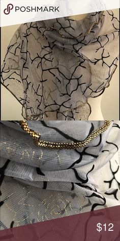 Scarf Beautiful scarf in gray with black and gold design. Perfect compliment to that little black dress! Approx 60L x 20W. Mesh-like see through material. NWOT Accessories Scarves & Wraps