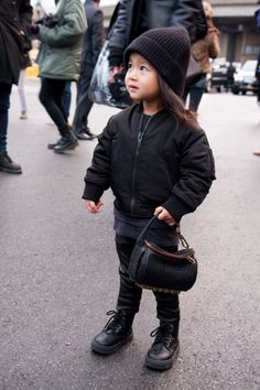 This little girl's name is Aila.  She is Alexander Wang's niece, and one day my future daughter will dress just like her.