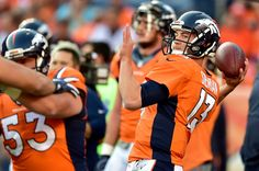 Trevor Siemian Photos Photos - Quarterback Trevor Siemian #13 of the Denver Broncos warms up before taking on the Carolina Panthers at Sports Authority Field at Mile High on September 8, 2016 in Denver, Colorado. - Carolina Panthers v Denver Broncos