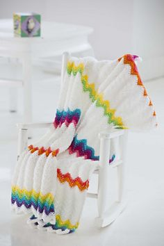 Modern Ripple Baby Blanket, free pattern by Lion Brand Yarn. Nice proportions of brights to white. #crochet #afghan #throw