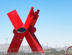 """""""The X,"""" or """"La Equis,"""" is located in Juarez, Mexico, by the bank of the Rio Grande. An artist by the name of Sebastian designed this statue. Many have heard of the violence along the border of Juarez and El Paso and this giant """"X"""" symbolizes the spilled blood of the drug wars. The monument is near"""