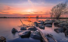Sunset near the city Kampen along the river the IJssel in the Netherlands