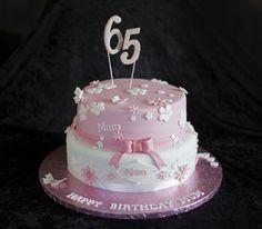 pink and white 65th birthday cake