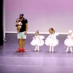 Dad rescues daughter who started crying during her dance recital. : funny