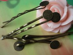 50 pcs 42mm Antique Bronze Vintage Brass Wave Shape Hair Clips Bobby Pin Hairpins with 8mm Pad g45580. $2.95, via Etsy.