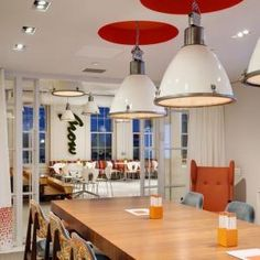 Trainspotters.co.uk - Large Czech pendant lights, with repainted white shades and glass diffusers. Axiom Law - New York USA