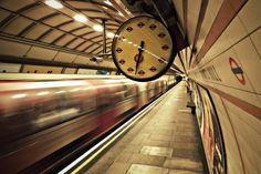This station has one of the very few clocks on the London Underground where all of the numbers are replaced with roundels. Description from now-here-this.timeout.com. I searched for this on bing.com/images