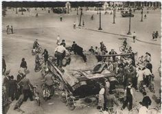 French civilians inspect a Panther knocked out by a French M10 at the Place de la Concorde in Paris 1944
