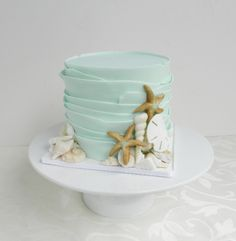 Small, simple, perfect for small beach wedding. Rustic beach wedding cake by Cake Whisperer