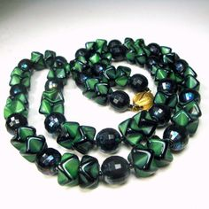 Black and Green Picasso Glass Bead Necklace, Long Strand of Stunning Art Deco Beads This very handsome glass necklace is 23 long ( 58.42cm ) the deco zigzag black and green Picasso beads are 1/2 wide ( 1.27cm ) the black glass round beads are faceted 3/8 wide or 10mm ) It is a lovely color green glass and very classy Traditional!! Gift worthy and THIS necklace is immaculate, only the gold metal depression catch shows a slight bit of darkening and wear on the back ------------------ PLEASE…