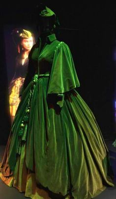 "Designed by Walter Plunkett: the infamous green ""Curtains Gown"", worn by Vivien Leigh as Scarlett O'Hara in ""Gone With the Wind"", on display in the Hollywood Costume Exhibit at the Victoria and Albert Museum. Scarlett Dresses, Scarlett O'hara, Movie Costumes, Cool Costumes, Ballet Costumes, Beautiful Costumes, Beautiful Dresses, Vivien Leigh, Vintage Outfits"